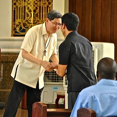 Ed Fermin of Miriam College hands to Cardinal Luis Antonio Tagle the working document of the Congress on the Filipino Family convened by school family councils, PTA particularly from Catholic Schools - NJ Viehland Photos